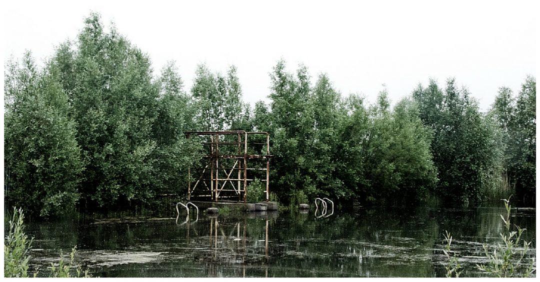 Overgelopen zwembad op domein Bloso Hofstade